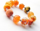 Lampwork orphan bead set of 12 orange renegade beads - amber lampwork orphan beads