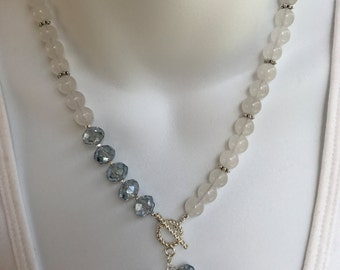 Asymmetrical quartz and crystal necklace and earring set