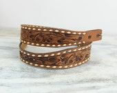 Vintage western belt, tooled brown leather, floral pattern, white lacing, tapered tongue (small size 29).