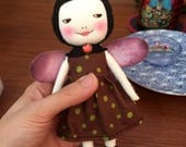 Handmade smiling butterfly doll