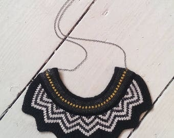 Knitted chevron bib necklace - Black and white with mustard detail trim