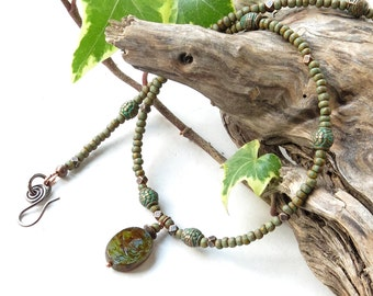 Beaded choker necklace - earthy green picasso beads & glass bird charm, antiqued verdigris copper
