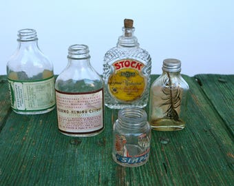 Eclectic collection of vintage pharmaceutical bottles...