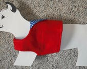 For Vincent: Little Red Doggie Vest, fleece and cotton with pocket and blue and white polka dots lining.