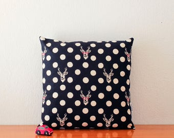 Black pillow cover with large polka dots and deers