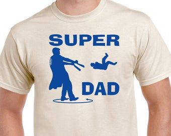 Funny Super Dad T-shirt. Admit it, you always wondered if your arms would come off. Direct screen printed with Royal Blue ink.