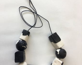 Black and white geo forms and spheres Handpainted and Handmade Clay Bead Necklace