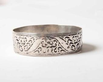 Engraved silver bangle with swirls and floral motifs from the Anti Atlas region of Morocco
