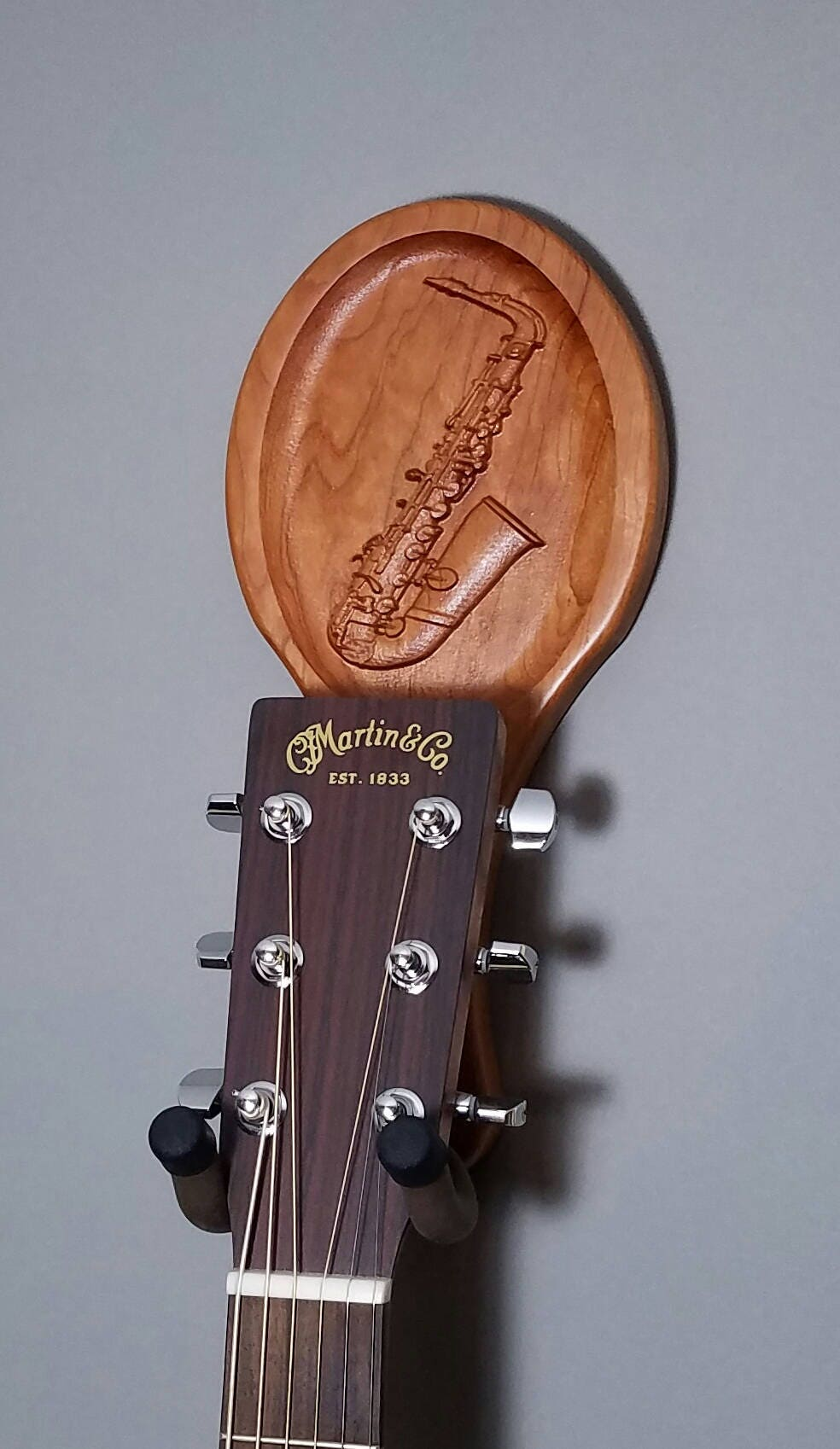 Guitar hanger cherry wood player saxophone carving