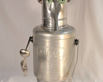 """Metal, robot sculpture, up cycled object, folk art made from re-cycled materials. Whimsical, one of a kind piece. Meet """"Sugar Daddy""""."""