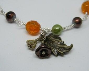 Autumn Forest Bracelet and Necklace, Wire Wrapped Links, AB Faceted Orange, Olive Green Pearls, Brown Beads, Bell Flower, Leaf Charm