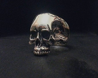 A solid  Sterling Silver Keith Richards Skull Ring with realistic details