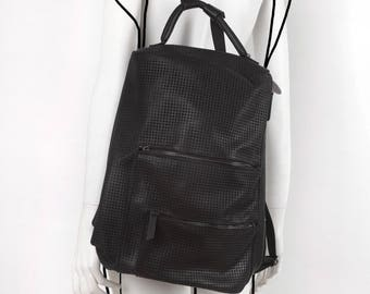Leather black perforated backpack
