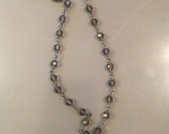 crystal beaded chain with a cross pendant