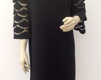 1960s dress with fabulous cut out sleeves vintage
