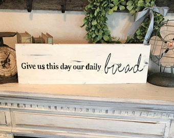 Give us this day our daily bread sign / lord's prayed sign / our father sign / prayer sign