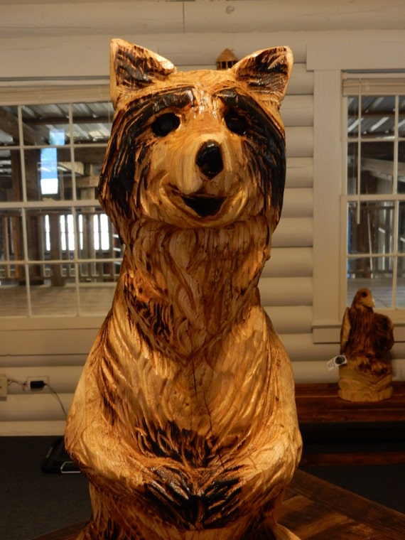 Chainsaw carving mr raccoon