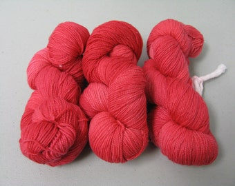 hand dyed Sock Yarn Maniac  solid-ish red limited quantity 75/25 % wool nylon superwash 100 grams 430 yards plus lurex gold glitter strand