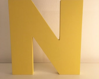 letter in colored wood
