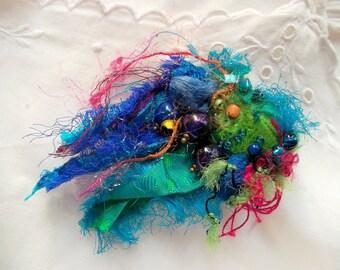 Embroidered fabric brooch green blue pink silk kokons silk cords recycled sarisilk fiber brooch OOAK