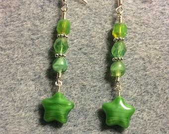 Opaque lime green Czech glass star bead dangle earrings adorned with lime green Czech glass beads.