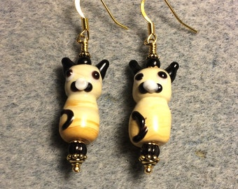 Tan and black lampwork cat bead earrings adorned with black Czech glass beads.