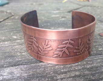 Handcrafted etched copper cuff with leaf pattern