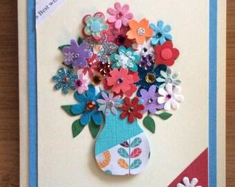 Pinky/blue vase of flowers