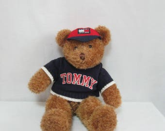 Vintage Tommy Hilfiger Plush Stuffed Bear wearing a Sweater and a Cap with Tommy Logo Collectible SEE Details