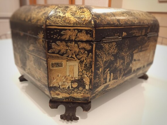 Mid 19th century chinoiserie japanned tea caddy complete with pewter containers with ivory topped lids