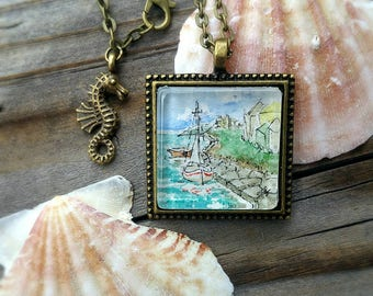 Sailboat necklace. Hand-painted miniature wearable art illustration of a boat docked at a quay