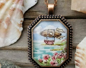 Zeppelin on a zephyr hand painted watercolor necklace. Watercolor steakmpunk / vintage style zeppelin miniature painting on the sea, poppies