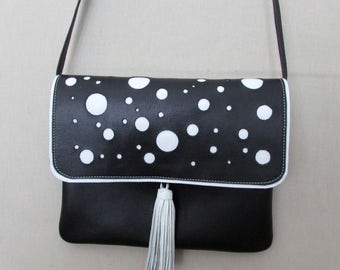 Cross body black leather bag with white polka dots