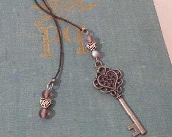 Silver key with purple beads and silver Celtic hearts bookmark