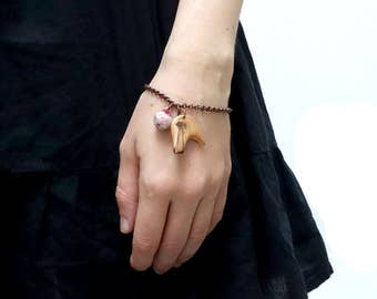 Wooden bracelet, twisted piece of wood and handfelted wool pearl