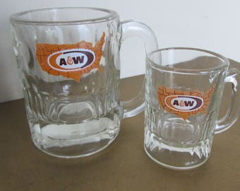 Two A&W Root Beer Mugs: Baby 2 oz. and Momma 6 oz. Brown and Orange Logo