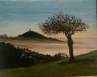 NOT A PRINT  Sunrise in Miniature of Glastonbury Tor in oils. 3x2 canvas with small easle.