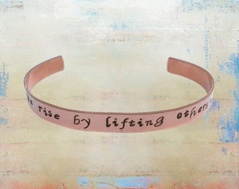 """We Rise By Lifting Others Up Hand stamped Cuff Bracelet - Mantra- Yoga Jewelry - Love Your Tribe 1/4"""" copper …"""