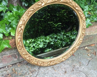 Gold ornate mirror lovely gold mirror with Bevelled edge.