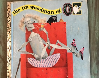 The tin woodman of OZ / Vintage Little Golden Book The tin woodman of OZ First Edition 1952 by L Frank Baum