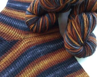 Hand dyed self striping merino sock yarn - Abandoned Ironworks
