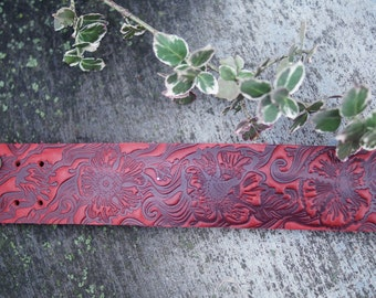 Red leather bracelet. Malva bracelet. Red malva bracelet. Floral pattern. Floral emboss. Red floral leather bracelet.