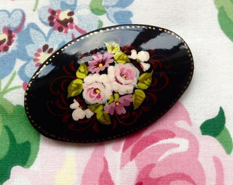 Large oval painted brooch