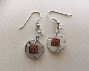 Sterling silver and copper dangle earrings.