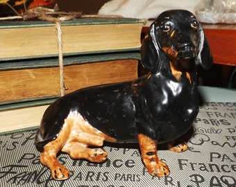 Mid-century (c.late 1940s - 1950s) Coalport black-and-tan colored daschund figurine. Made in England.