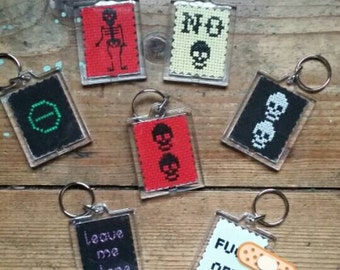 Cross stitch keyrings. Choose your design. Type O Negative, skulls, skeleton, f**k off, glow in the dark skulls, leave me alone, or No.