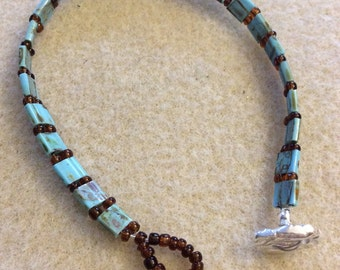 Turquoise colored beaded bracelet