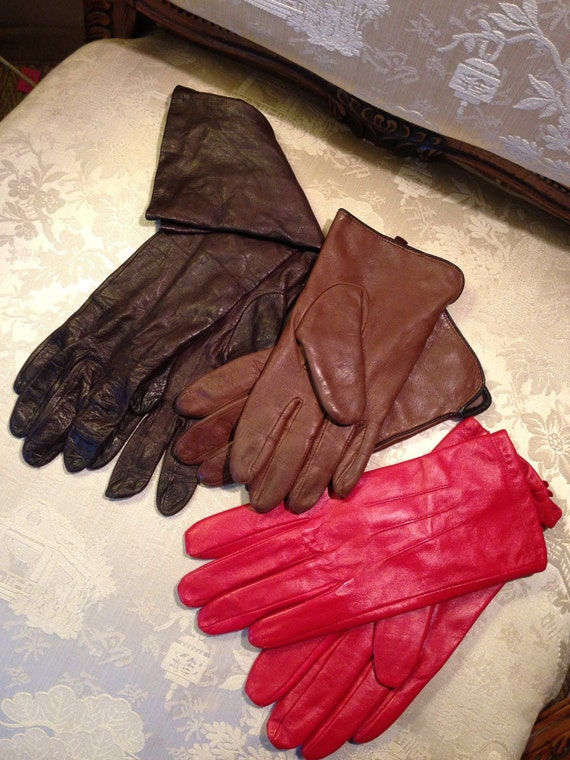 3 pairs vintage 60's leather gloves. Soft. Two pairs brown and 1 red. 60's. strong