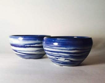 Blue and white set of small dip bowls