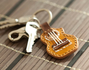 Hand stitched leather key chain, Vegetable tanned leather with Ukulele design, totally hand made